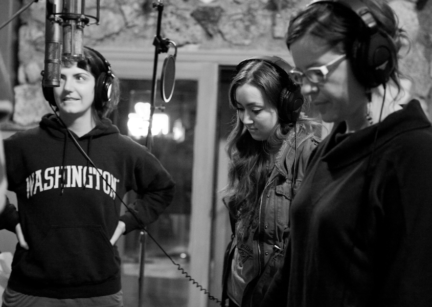 Photo: Carrie Robinson Katie Jacobson, Anna Freedman and Flora McGill listening to Paul Kimble say funny things through the headphones
